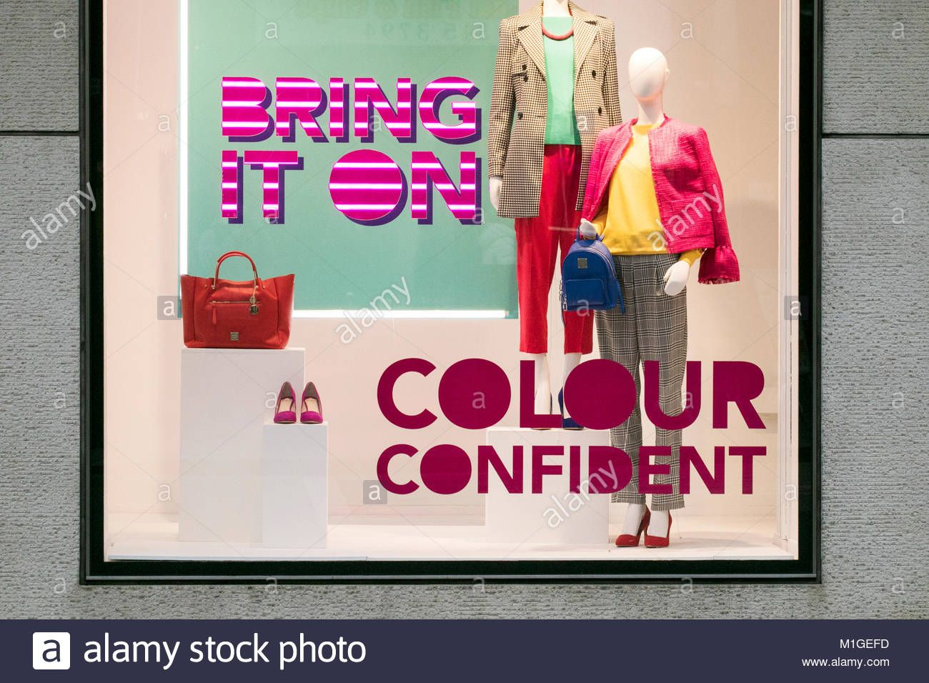 af1d4a82f25 Clothing store shop window displays showing the latest retail products on  sale