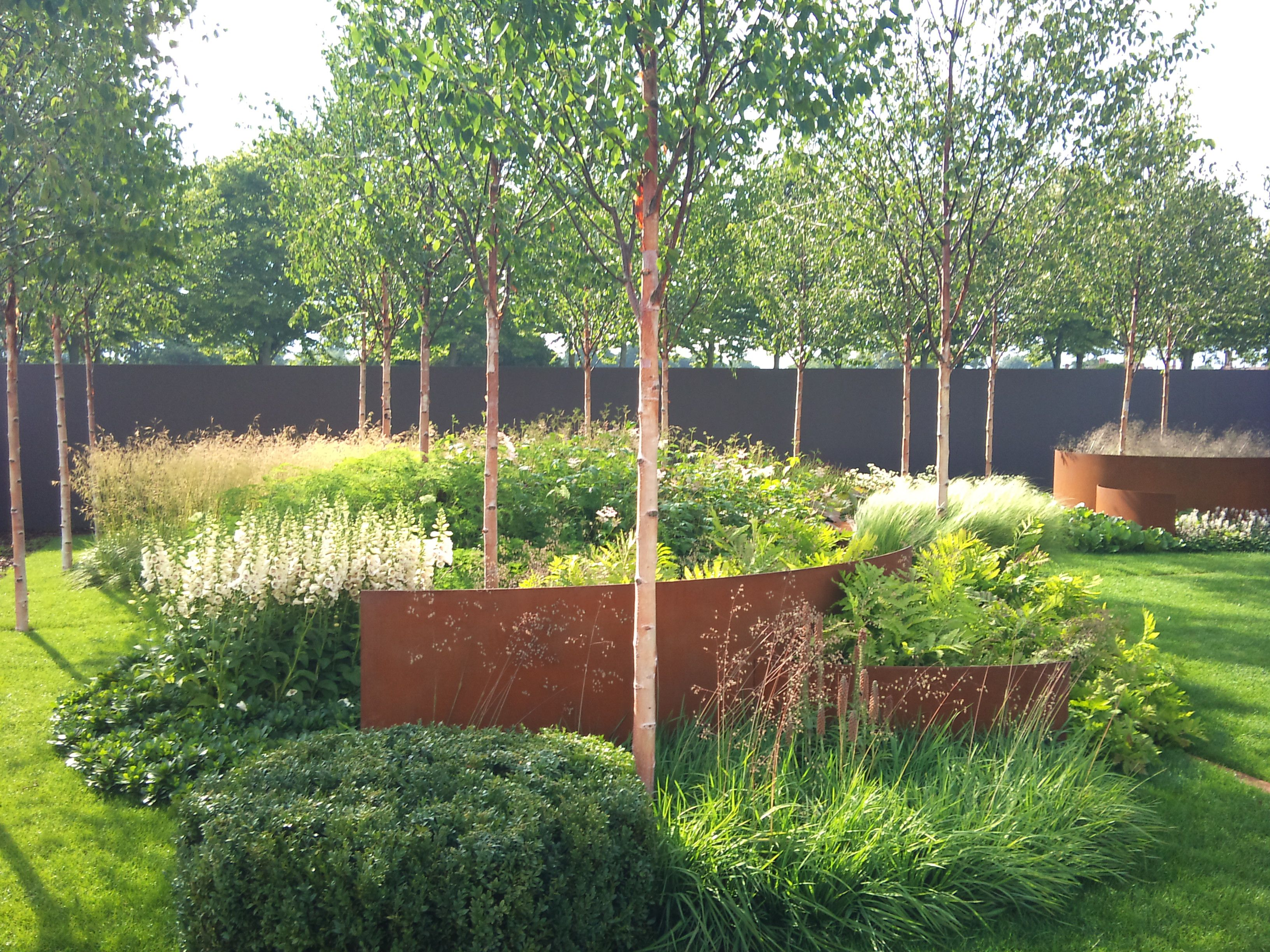 Love the corten steel integration in this garden the for Botanical garden design