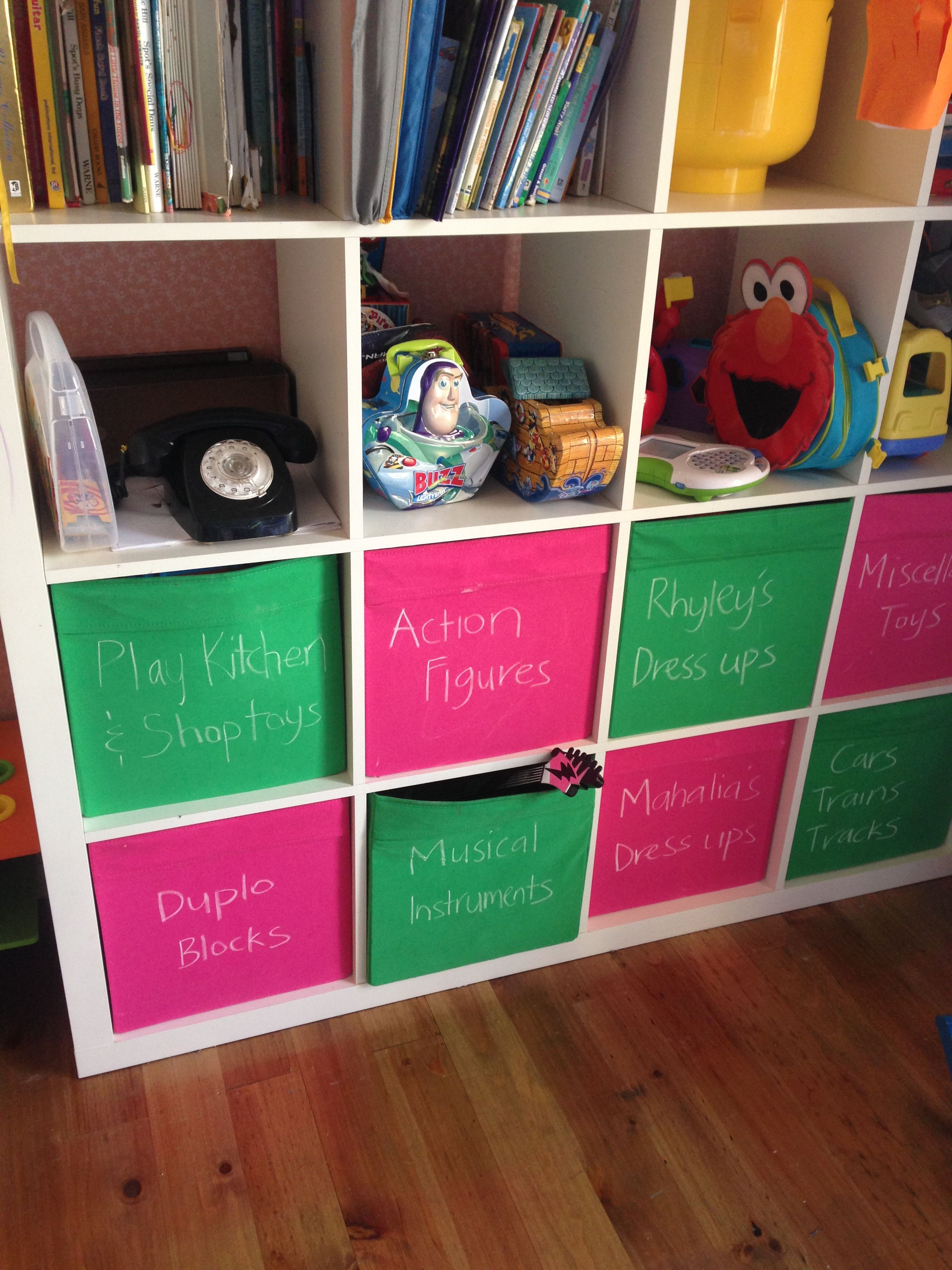 kids storage idea cube storage shelves from ikea pink and green fabric storage boxes keep. Black Bedroom Furniture Sets. Home Design Ideas