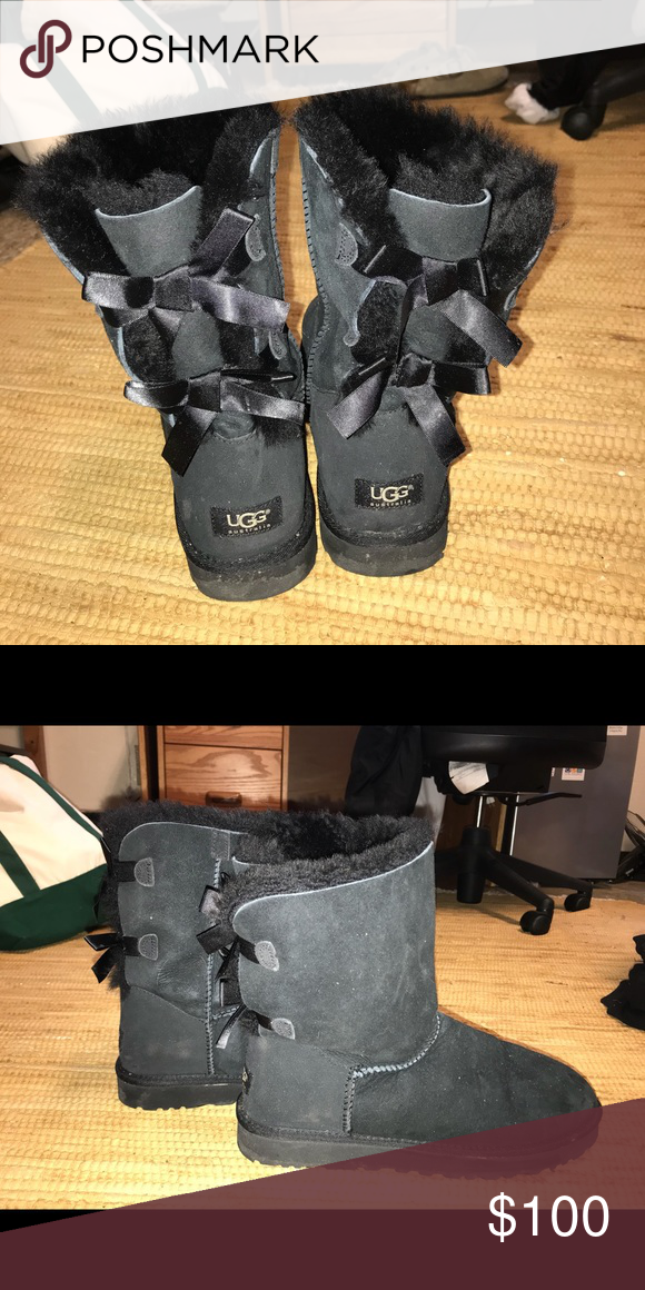 black short UGG boots with bows short black UGGs with black bows on the back.