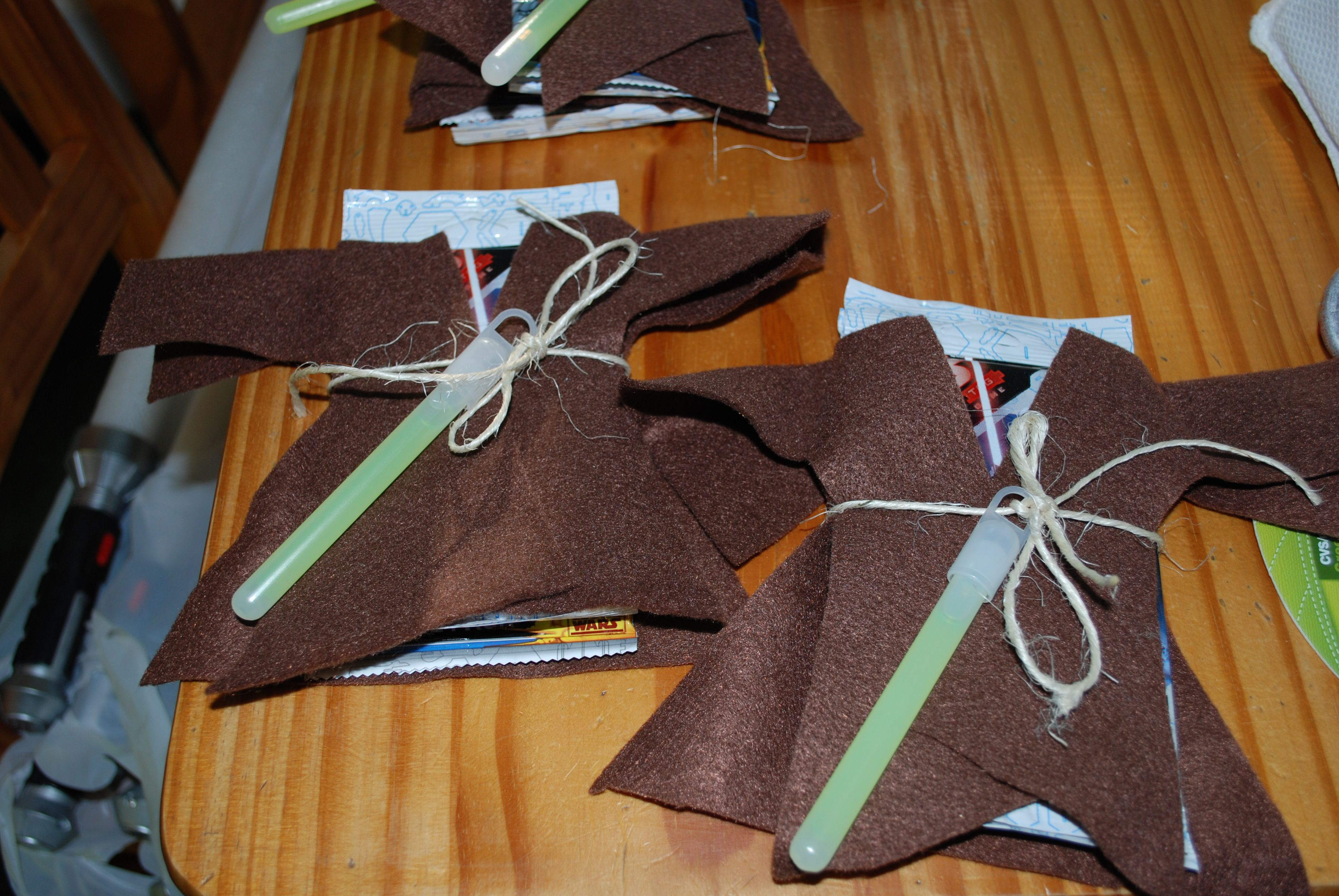 Star Wars Jedi favors.  I found star wars game cards, wrapped them in easy to make mini jedi robes made of felt, tied with kitchen twine, and added a lightsaber glowstick.