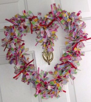 Rag a muffin door hanger for Valentines Day. Just use your festive fabric and hangers.  Twist it around, and tada!