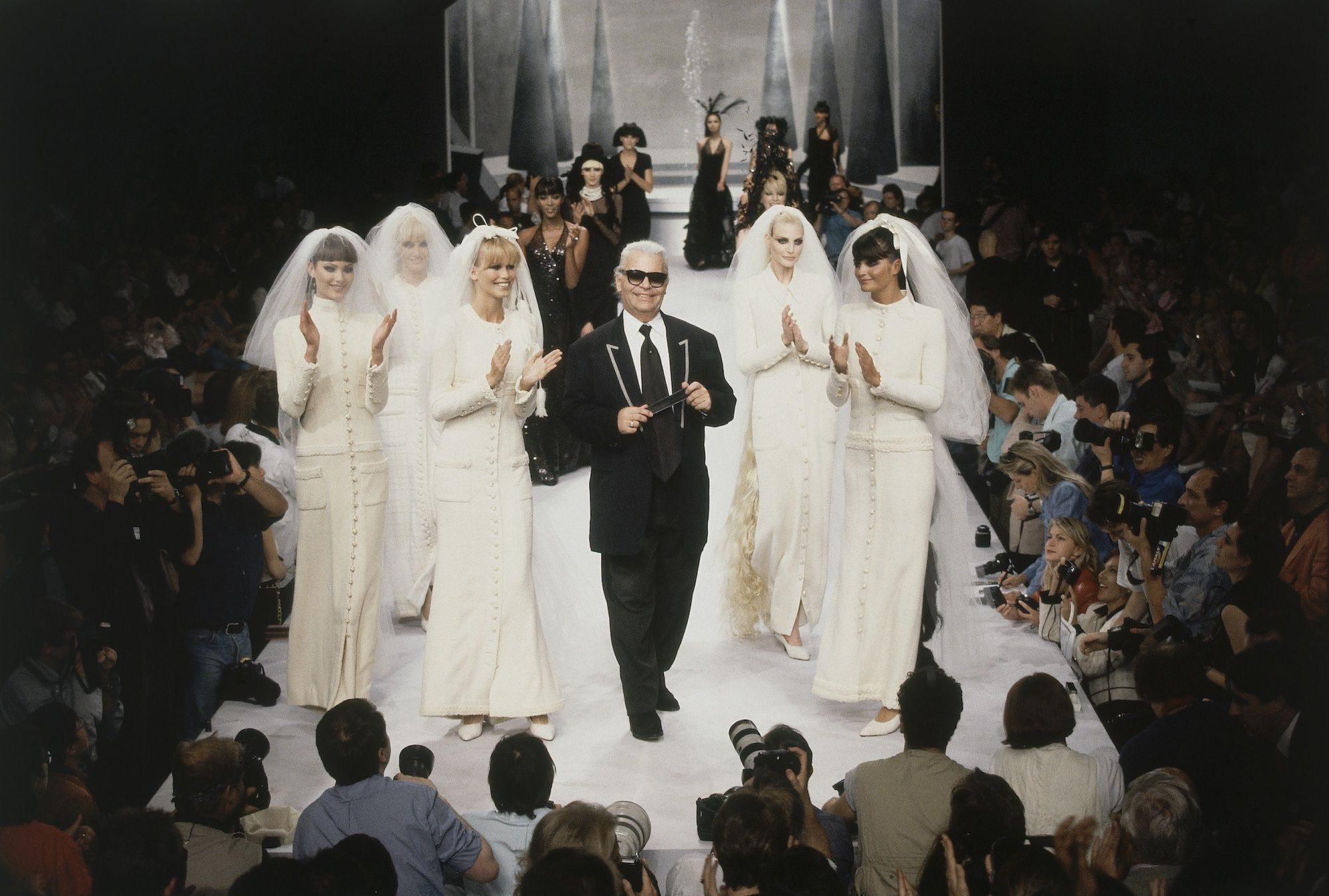 Everyone's favorite Uncle Karl surrounded by Chanel brides.
