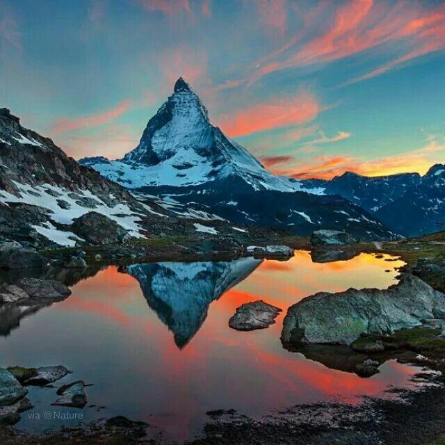 A mirror like reflection of Majestic Matterhorn Photography by © 2014 Albany Eroglu