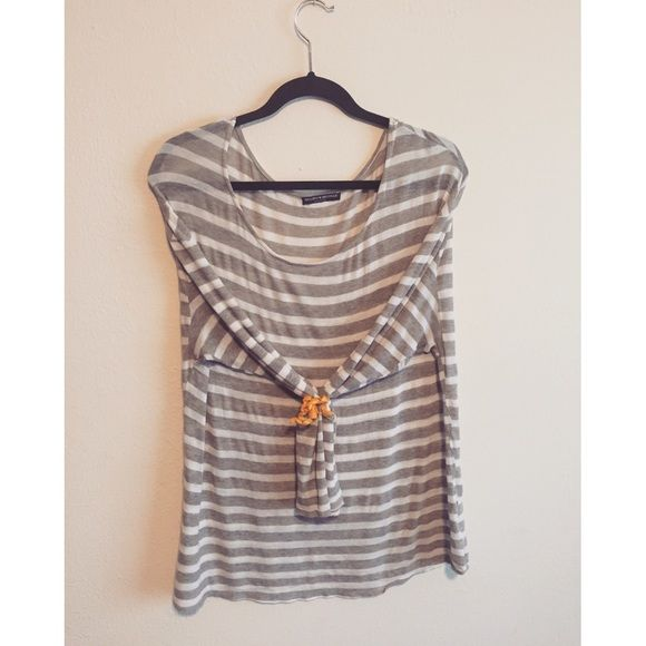 Brandy Melville loose shirt w/ light grey stripes In great condition, worn only a few times. I love pairing it with jeggings, an infinity scarf and boots. Perfect for those days when you want to feel comfortable but also look cute. Brandy Melville Tops Blouses