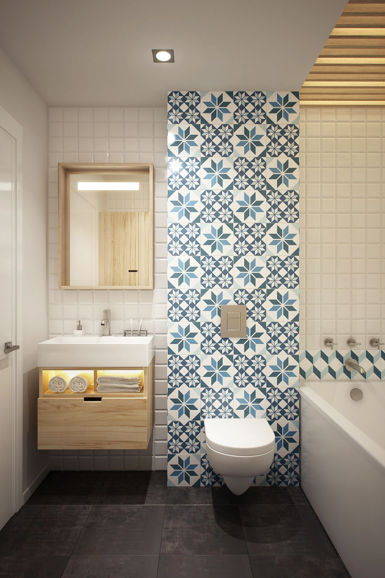 The patterned feature wall really helps to bring this small bathroom