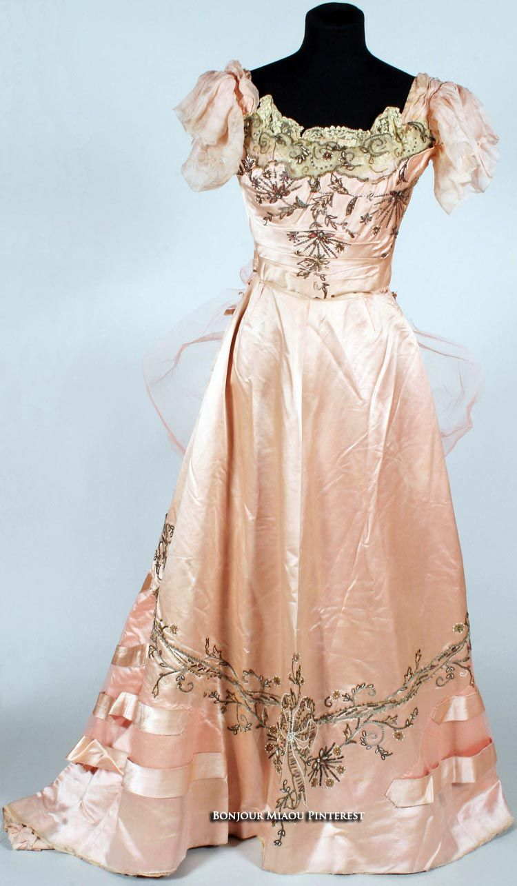 Edwardian two-piece evening dress of peach satin trimmed with faux pearls, metal threadwork, beadwork, colored diamante machine-embroidered net, and chiffon. Bonham's Auctions