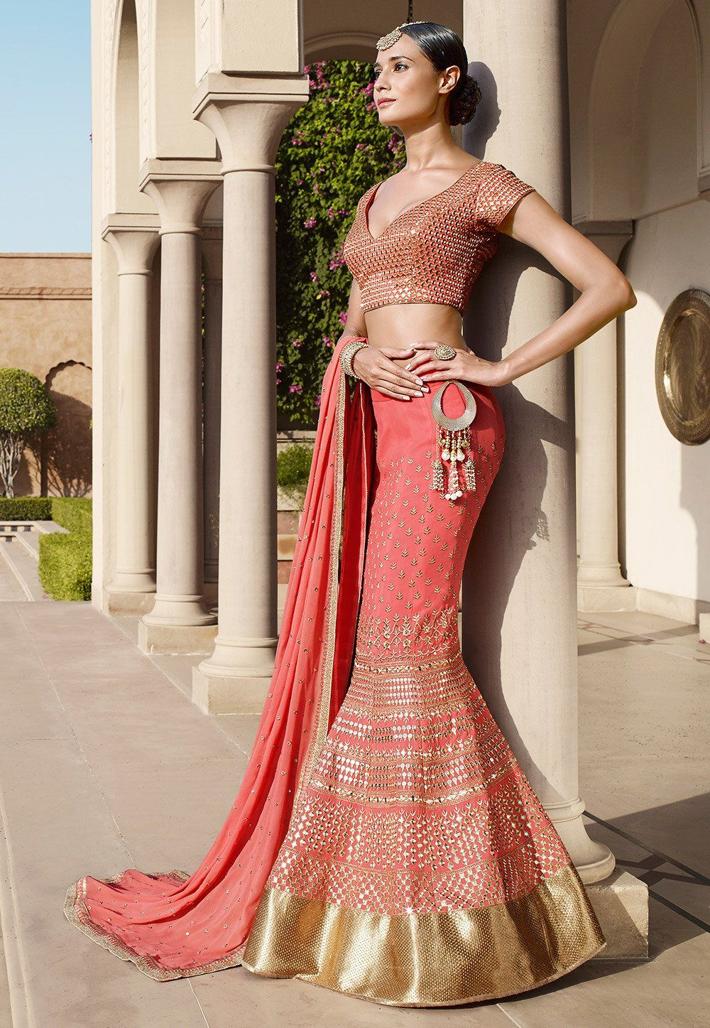 This gorgeous attire is enhanced with zari and stone work available