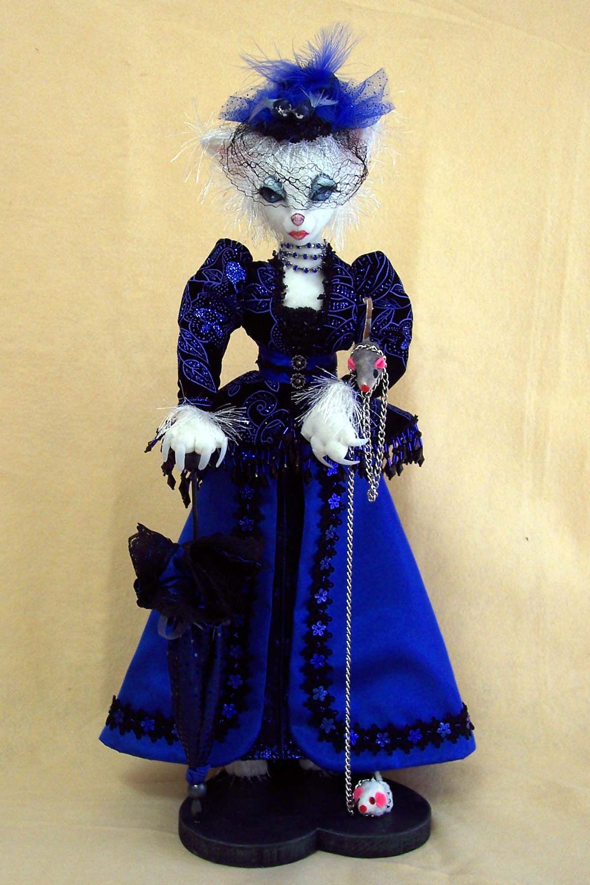 Catiana, white cat dressed in blue (the jacket fabric was