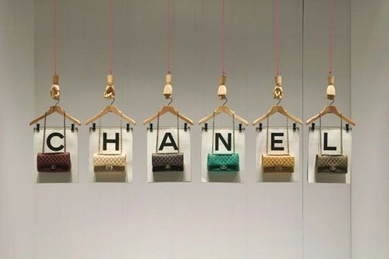 I love the purses hung off of old wooden hangers.  Would look neat with our lights!