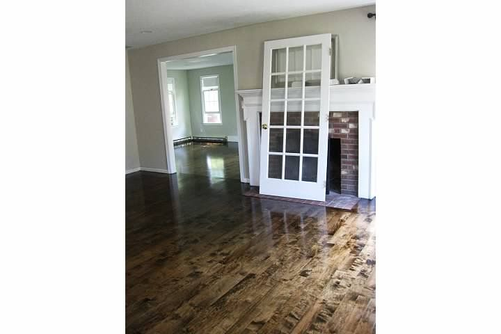 stained maple floors - maple does not take stain evenly. i think it looks really cool