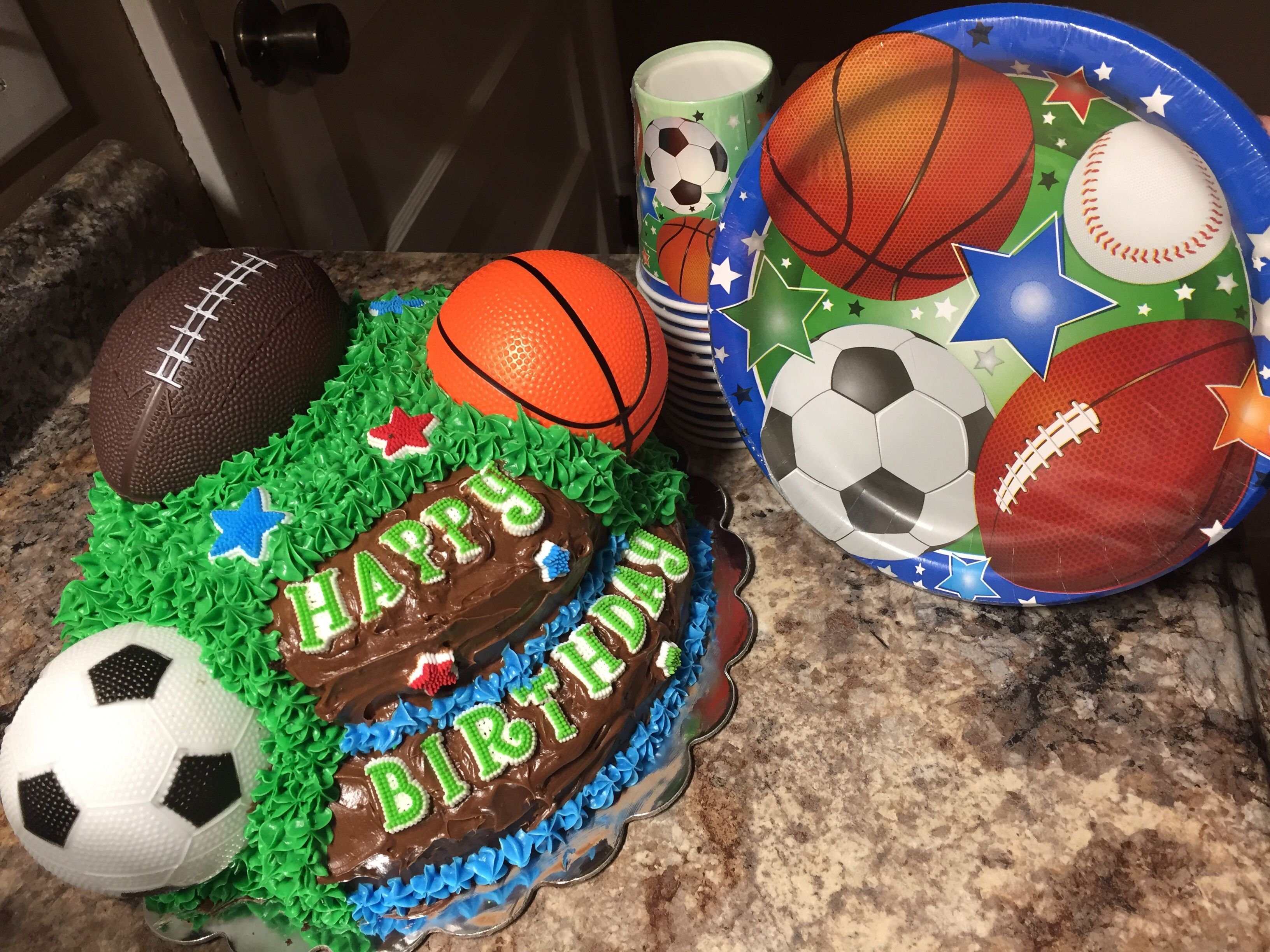 Sports Themed Cake Soccer Basketball Football Chocolate On Chocolate Grass Two Layers Jasper S 7th B Sports Themed Cakes 7th Birthday Cakes Themed Cakes