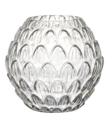 Transparant. Een ronde vaas van glas met een structuurdessin. Diameter aan de…