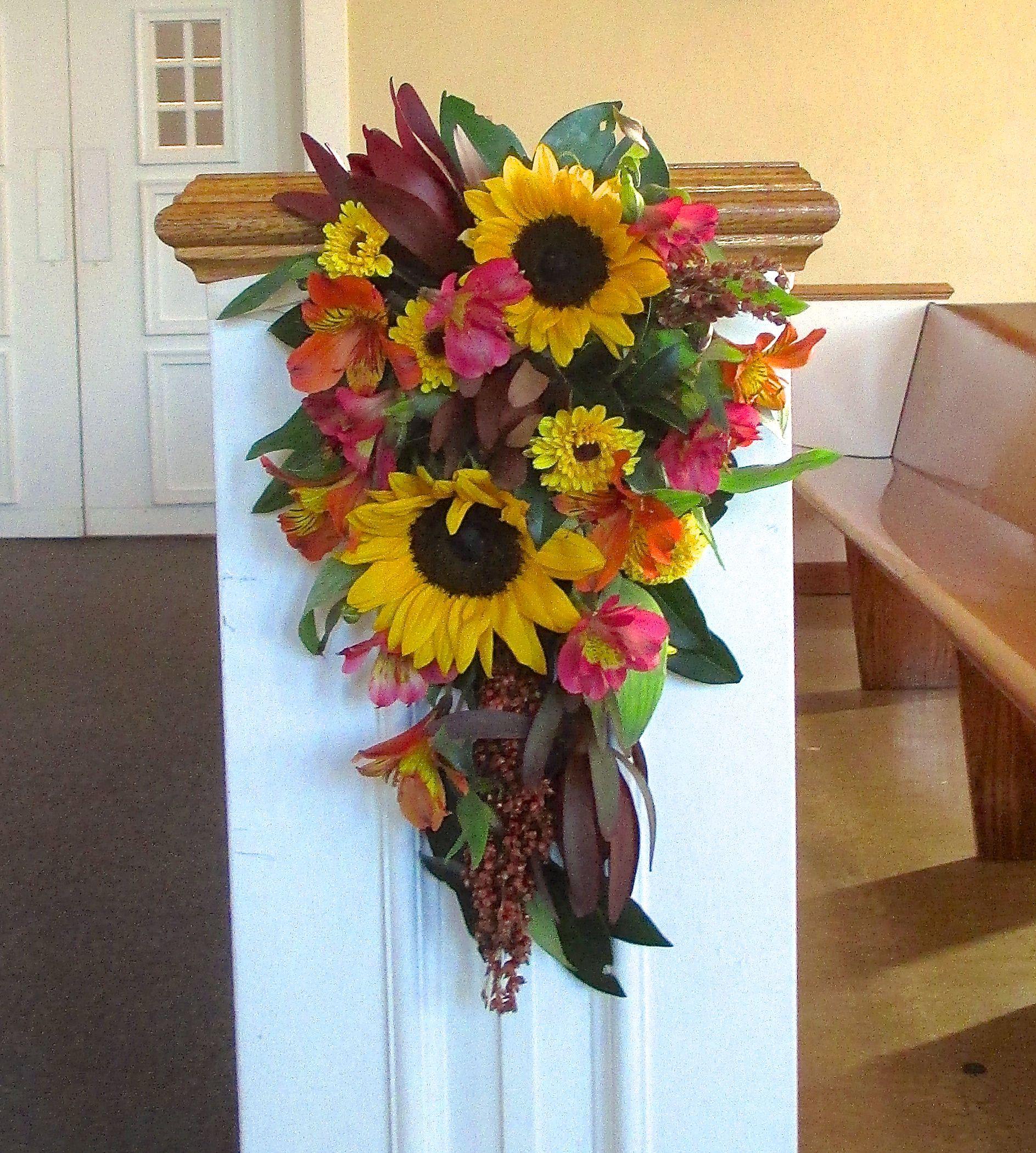 Wedding Flowers For November: Pew Flowers With Yellow Sunflowers, Mums, Burgundy Safari