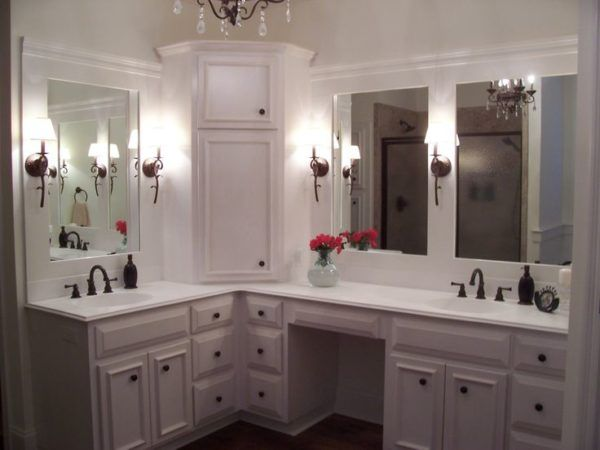 Corner Bathroom Vanity Cabinet With Integrated Marble Sink Using Kohler  Bellera Oil Rubbed Bronze Under Large Wall Mirrors Between Modern Rustic  Sconces ...