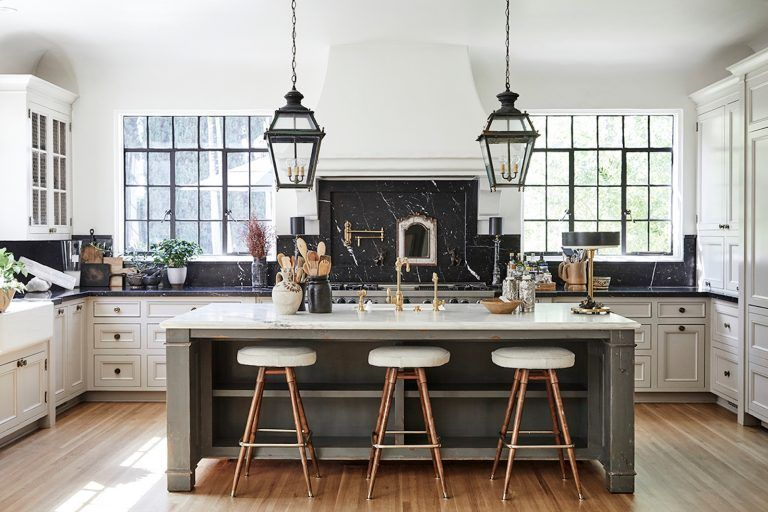 Nate Berkus S L A Kitchen White Cabinets With Black Countertops And Gray Island