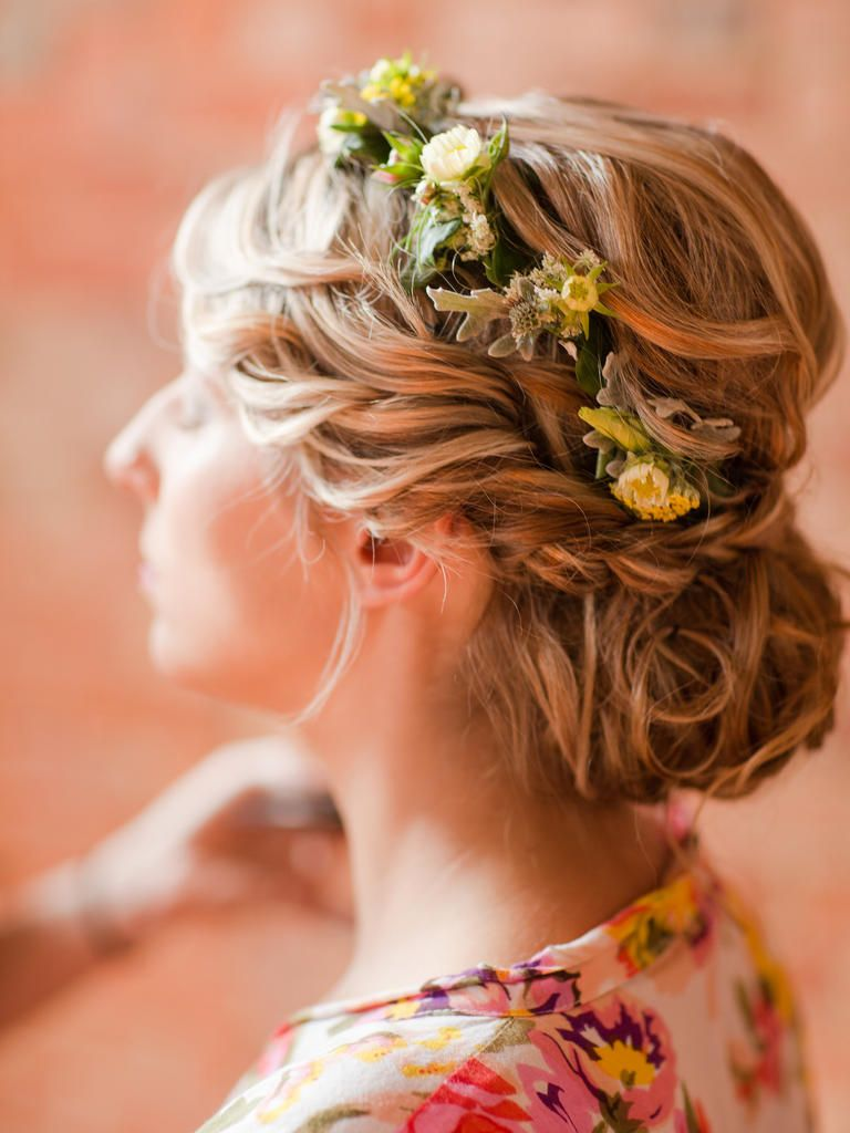 Your wedding hairstyle will be a bohemian masterpiece in itself with this twisted braid and small yellow flower crown.