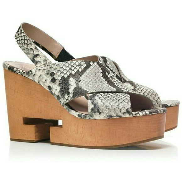 923d840a0138 Tory Burch Infiniti T Wood Wedge Directly from Tory Burch - Our Snake-Print Infinity  T Crisscross Clog Sandal reinterprets the traditional wood-soled shoe ...