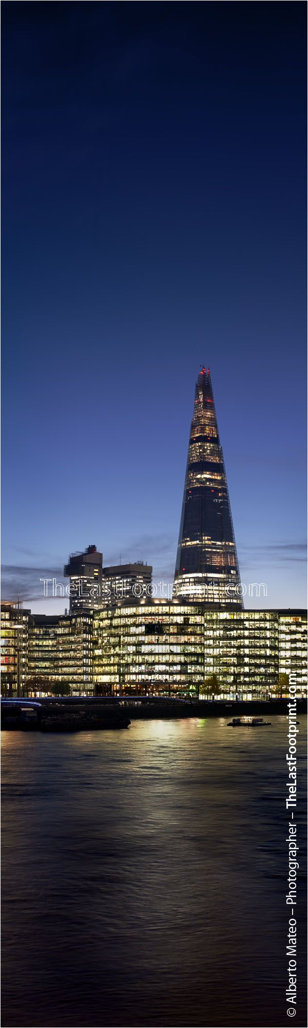 The Shard, London, United Kingdom. This is the last Skyscraper in Europe, it opened last February. Architect: Renzo Piano. This building located at Thames river shore provides a great counterpoint to the classic lines of Tower Bridge. This picture was taken at dusk, on a clear day. The sky was very clean and the artificial lights of the surrounding offices give it a special character.