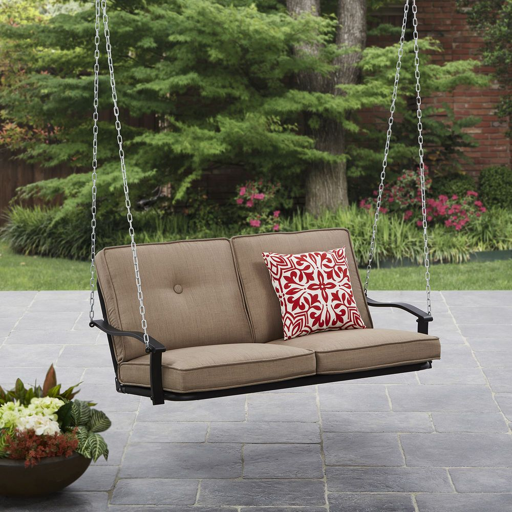 Person outdoor patio swing chair cushions garden porch steel