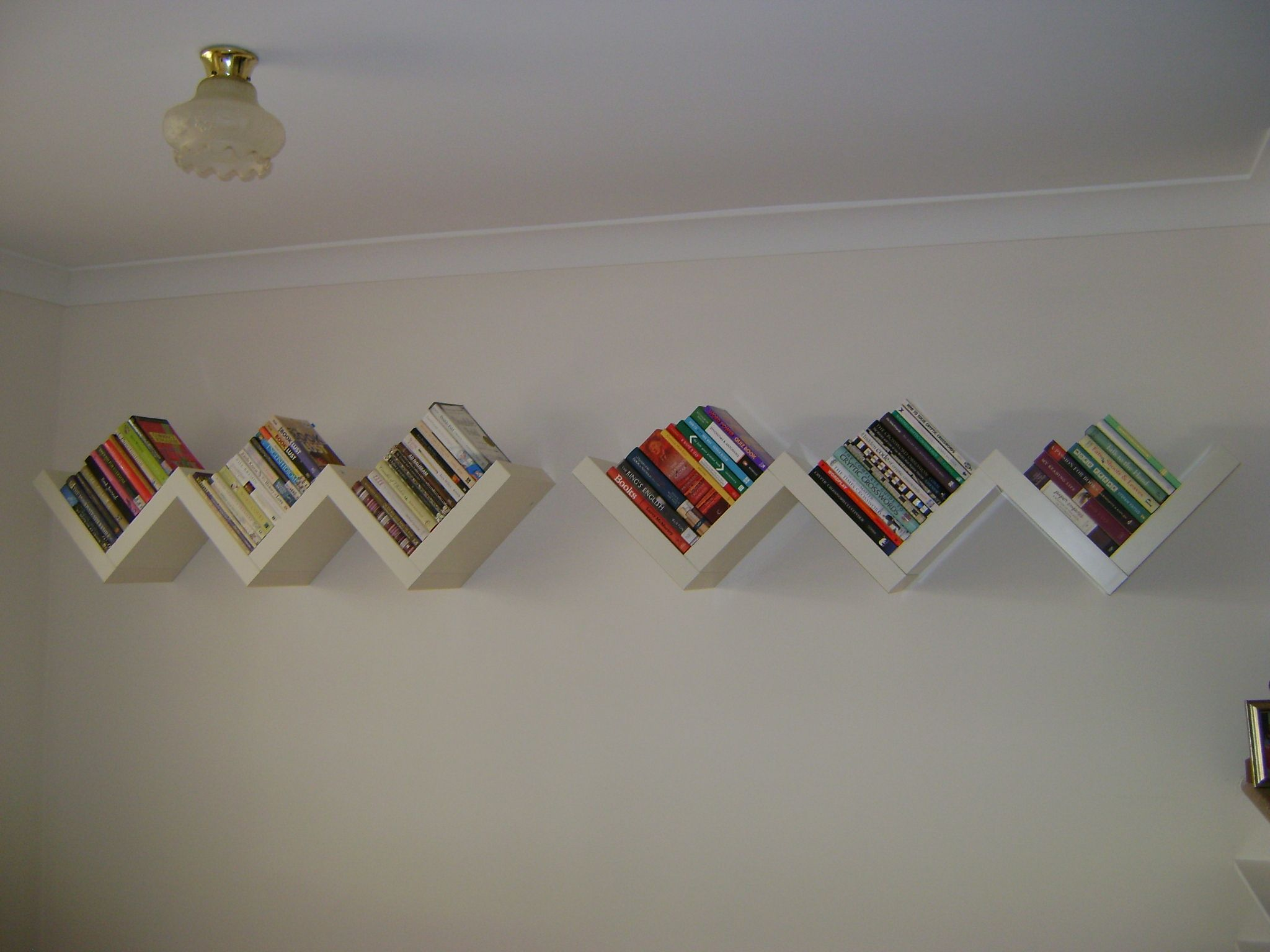 This Is My Ikea Lack Wall Mounted Book Shelves I Love The Look Of Them Particularly The Way The Books Are Wall Bookshelves Wall Mounted Bookshelves Ikea Book