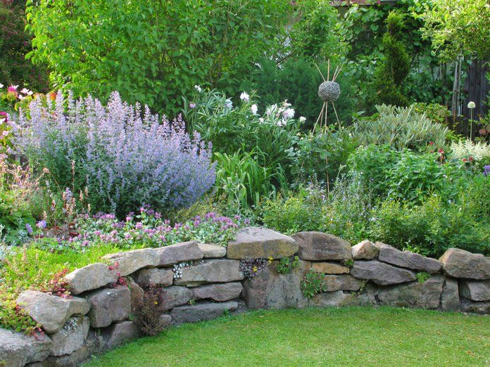 Photo of Dry stone walls: rustic garden decorations
