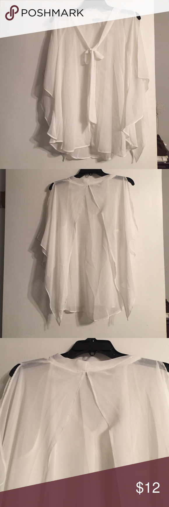 Do & Be white bat wing cape style top Sheer Do&Be blouse with cape like split pieces that come across the shoulders maybe even considered a dolman or batwing style - upon taking picture notices a very small stain on the sash you tie at the neck. Will be priced accordingly. ⭐️ please ask ALL questions before purchasing Do & Be Tops Blouses