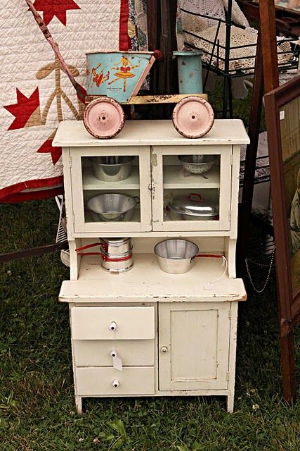 Vintage child's cabinet.  So sweet !  A  small. Version.  Of my mums. 60 s. cabinet