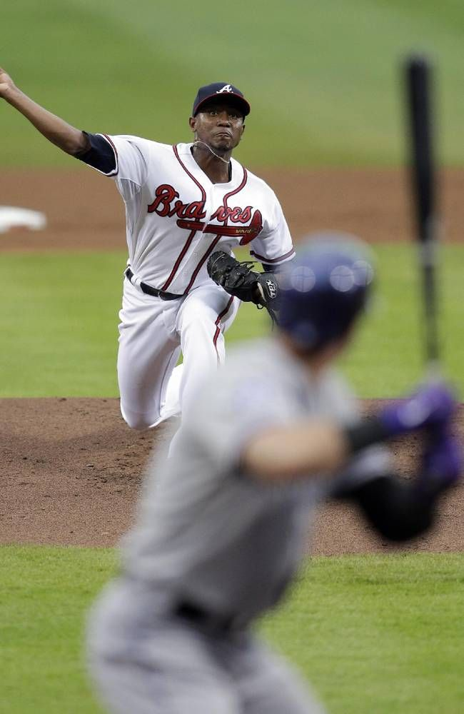 Atlanta Braves starting pitcher Julio Teheran (49) delivers a pitch during the first inning of a baseball game against the Colorado Rockies.