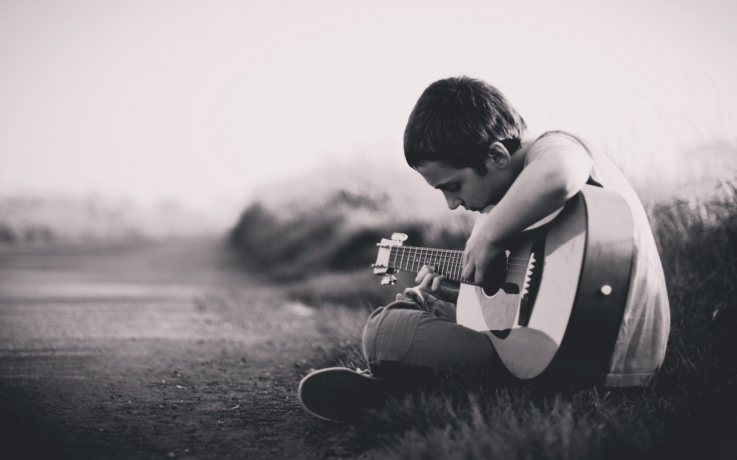 Lonely Boy Playing Guitar HD Images