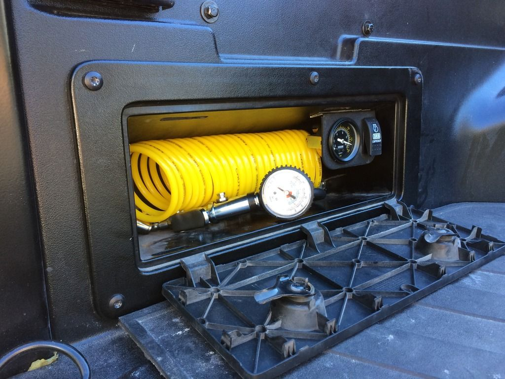Air compressor in bed storage. TRD Pinterest
