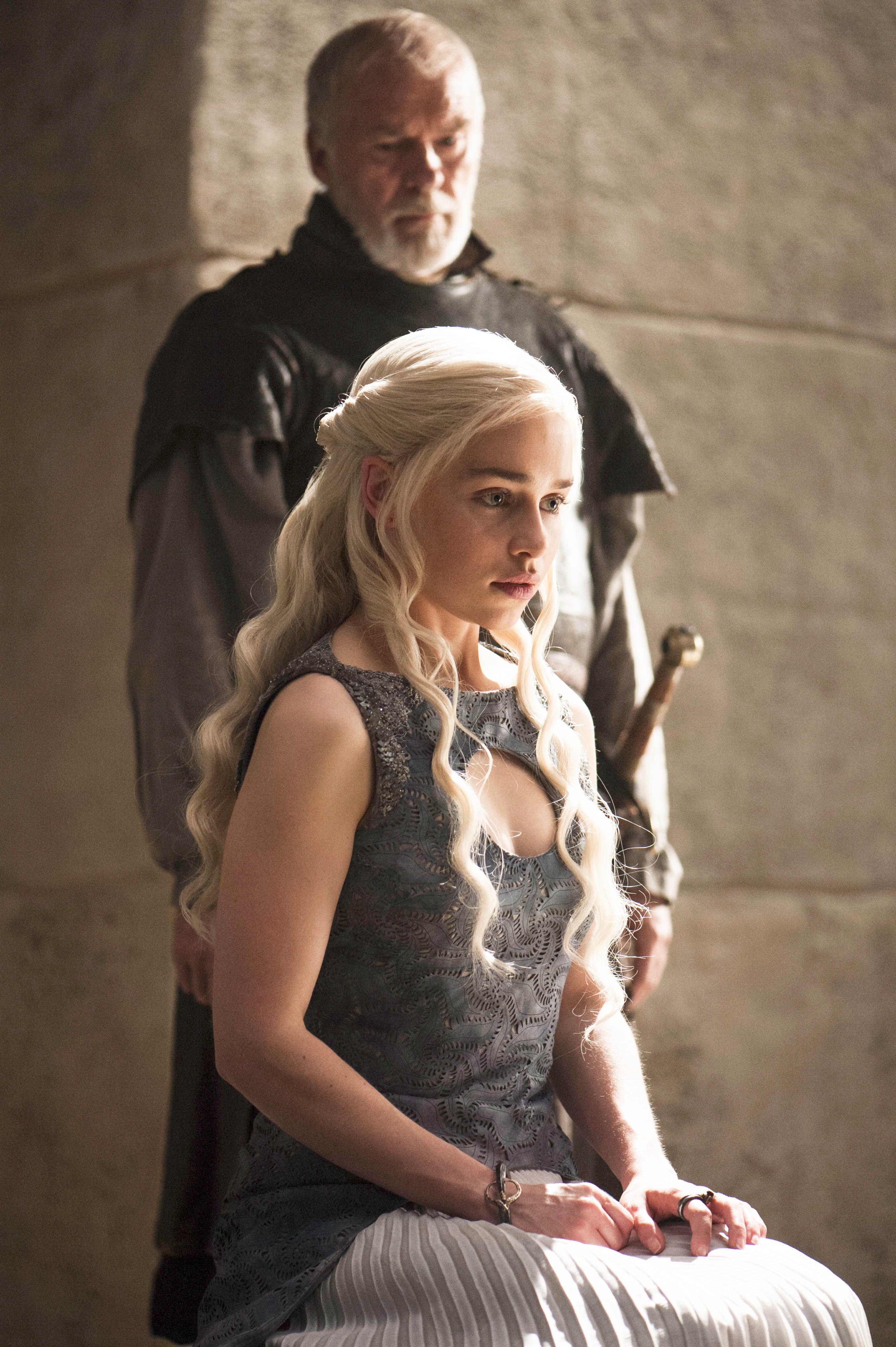 Emilia Clarke as Daenerys Targaryen and Ian McElhinney as