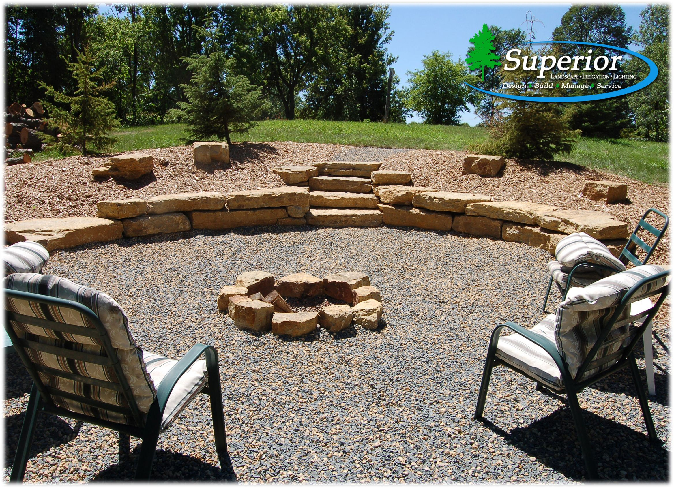 Natural fire pit area with limestone walls and crushed trap/limestone rock.