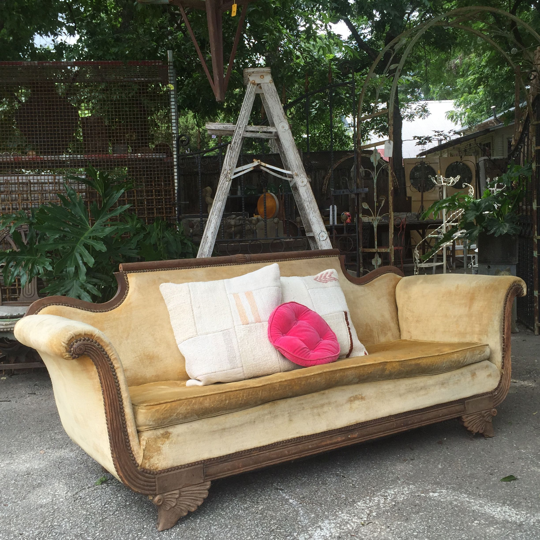 Groovy winged feet velvet sofa perfect rental for photo