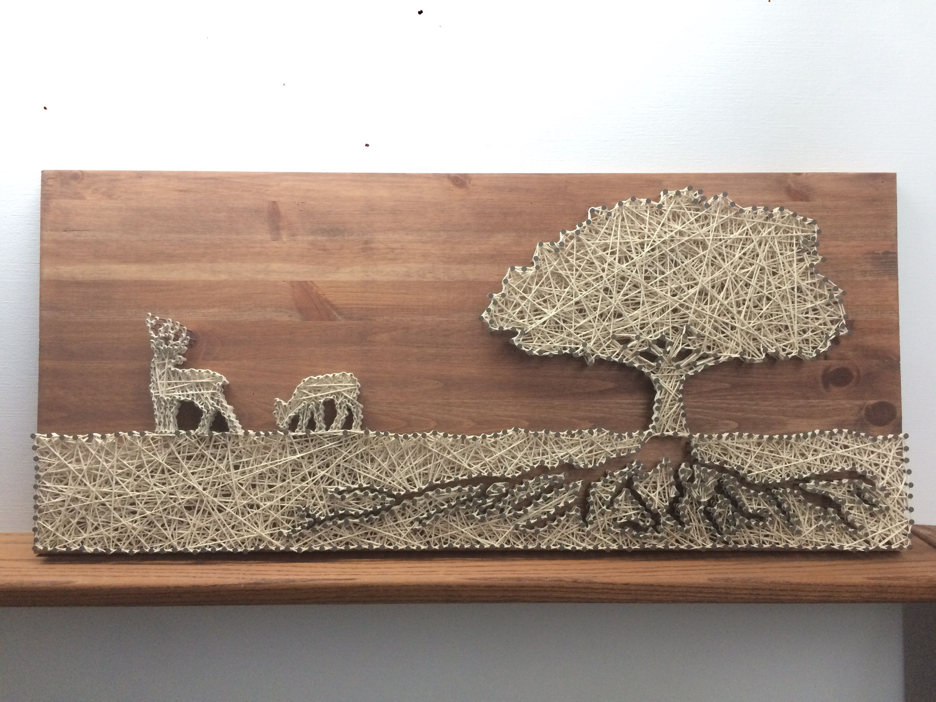 String art of 2 deers, tree and roots made by me and my boyfriend