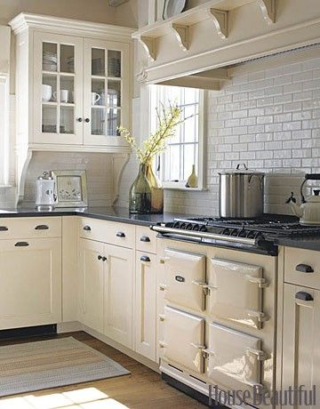Old Stove With Creamy White Cabinets And Subway Tile Back Splash