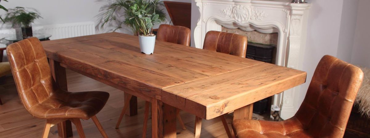 Reclaimed Wood Dining Table And Brown Leather Chairs