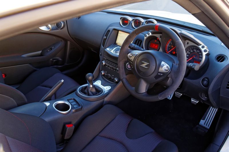 nissan 370z nismo a peak inside the coupe love the fine details the z on the steering wheel the dashboard is awesome nissan 370z nismo nissan 370z nissan nissan 370z nismo a peak inside the