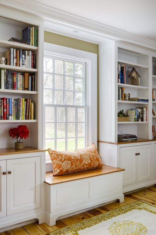 Groton, MA renovation with built in window seat and storage in custom  bookcases