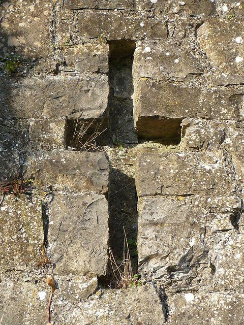 cross in a garden wall