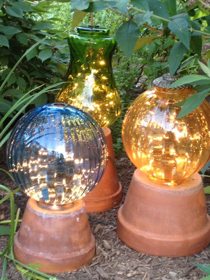 Garden Lights Made From Vintage Light Globes With White Light String Inside.