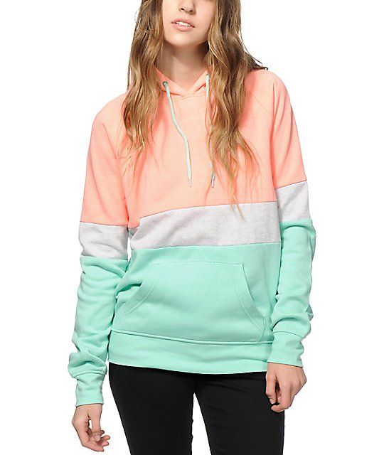 a44612f1bdad Update your wardrobe with some bright colors thanks to this cozy pullover  hoodie made with a neon coral