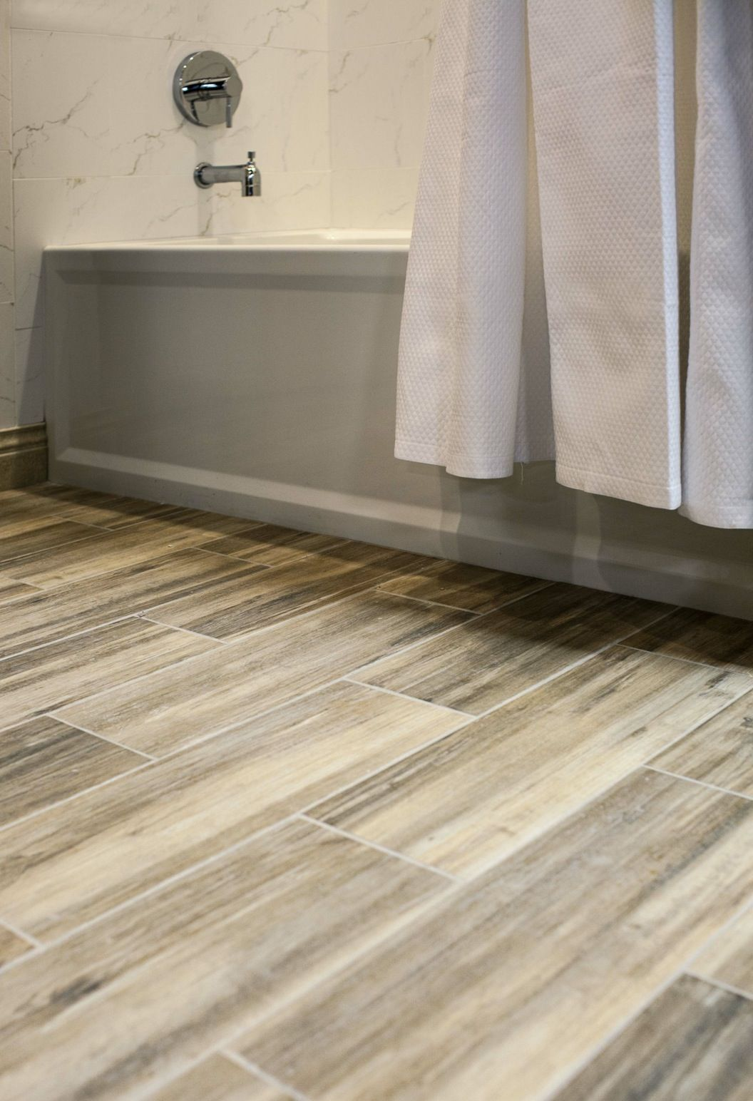 faux wood ceramic tile in the bathroom. easy to clean and still