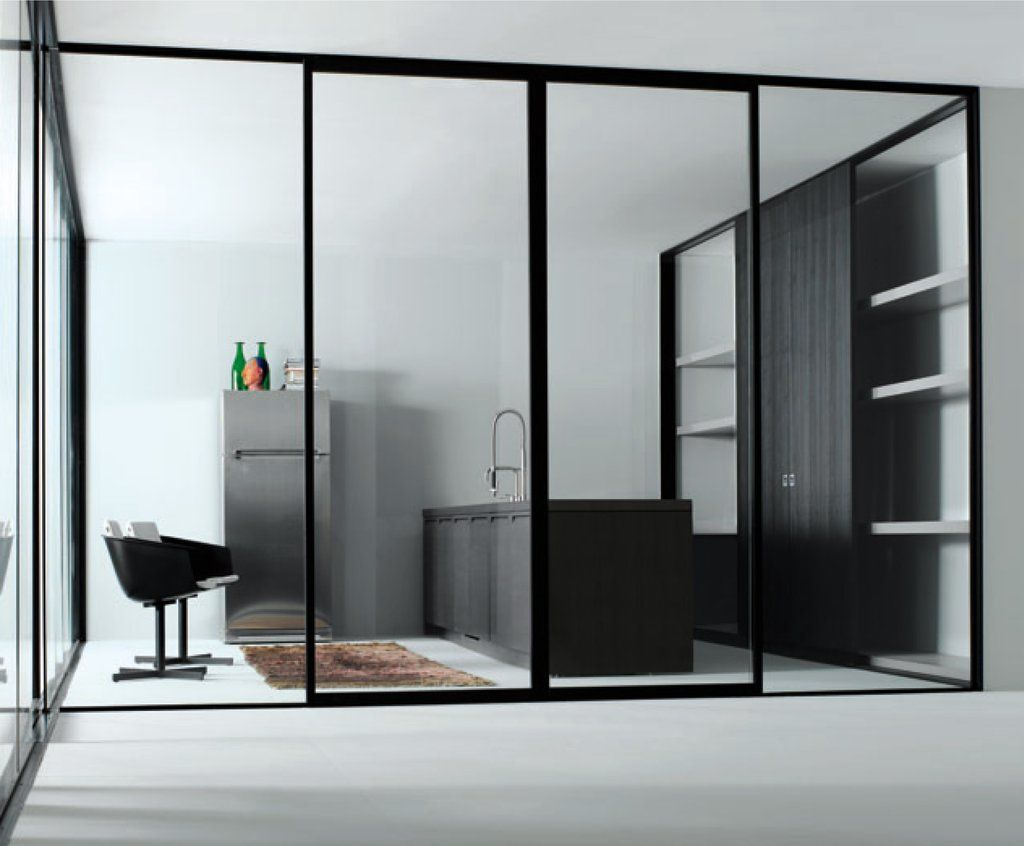 Black glass framed doors google search hotel hunter for Sliding door partition wall