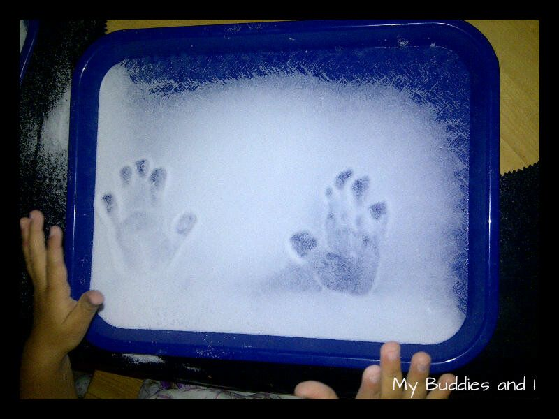 Salt Handprints - playing with salt on a tray