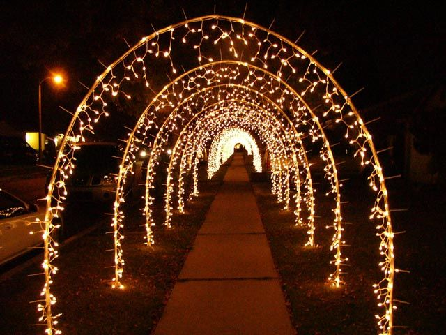 have people hold strands of christmas lights to make a tunnel for ...