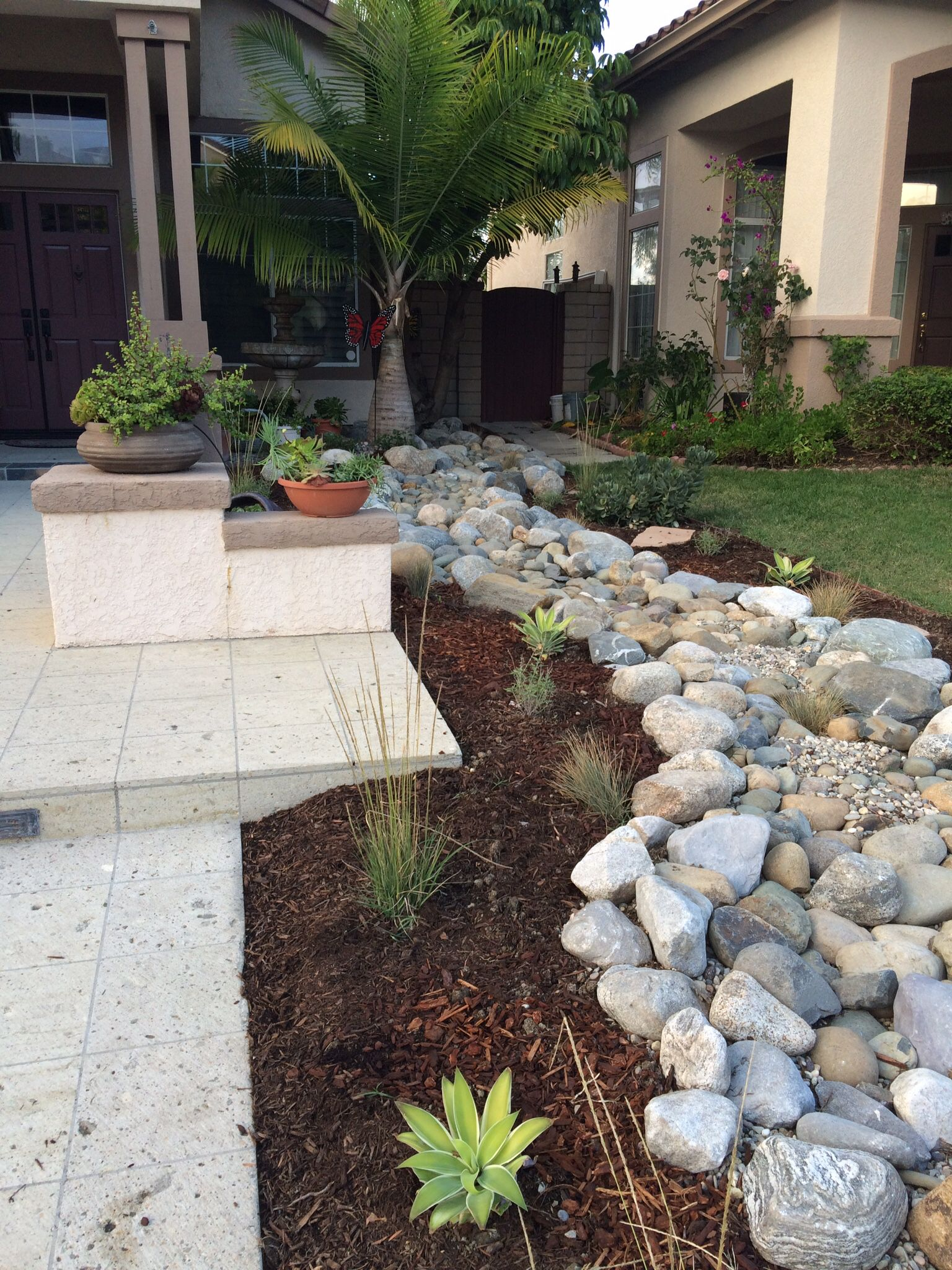front yard dry creek bed and drought