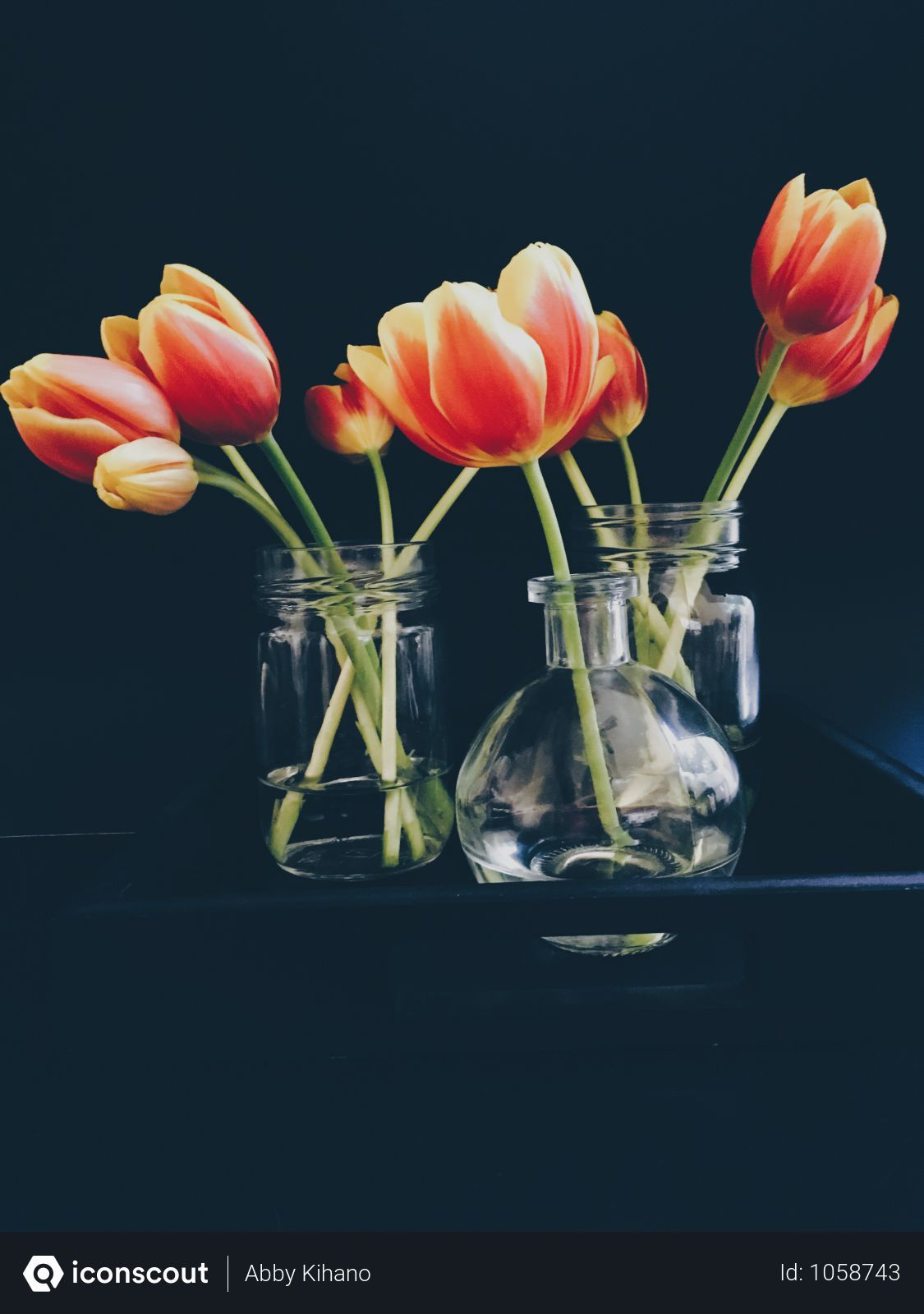 Free Red And Yellow Tulips In Clear Glass Jar And Vase