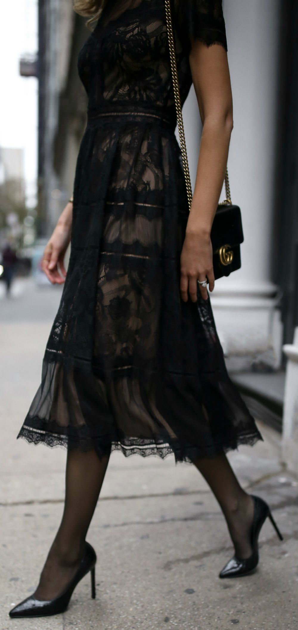 Black pleated aline tealength lace dress with scallop