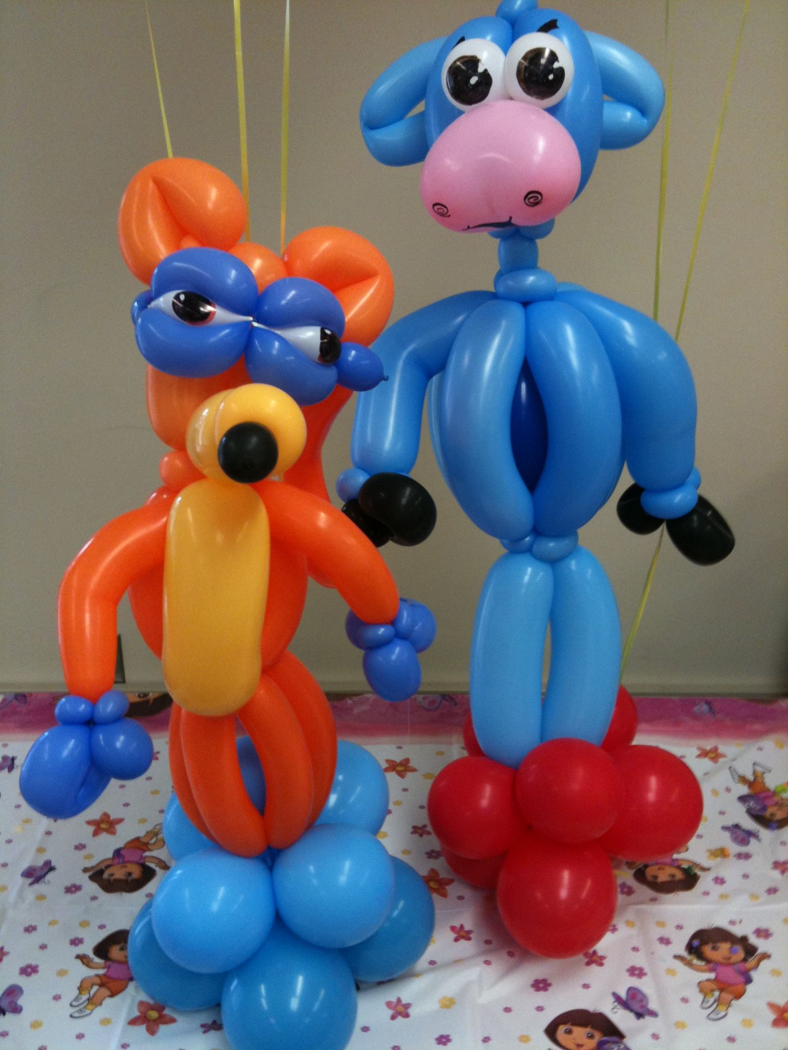 Dora themed cake table balloon decor by Zany Janie Balloon Decor